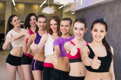 Group gesturing thumbs up Stock Image