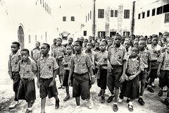 Group of Ghanaian children listens to the master Royalty Free Stock Images