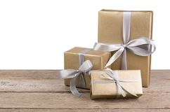 Christmas holiday gift boxes wrapped in paper on white background Stock Photos
