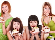Group girl eating chocolate cake. Royalty Free Stock Images