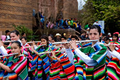 Group of girl flutists playing in a parade Royalty Free Stock Photography