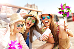 Group of girl friends having fun in the city Royalty Free Stock Photos