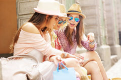 Group of girl friends resting after shopping Stock Image