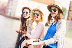Group of girl friends sightseeing the city Royalty Free Stock Photo