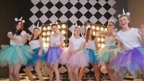 Group girlfriend dance battle in a fairy unicorn costumes, colorful air tutu skirts posing and dancing on camera. Happy. Happy young bride on girl s night out stock video footage