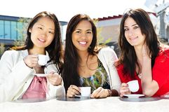 Group of girlfriends having coffee Royalty Free Stock Photography