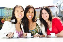 Group of girlfriends having coffee Royalty Free Stock Images
