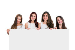 Group of girlfriends holding white board Stock Photo