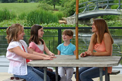 Group of Girls. Girls talking at a table Royalty Free Stock Image