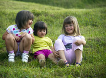 Group of girls. Girls playing and smiling in the grass Stock Photo