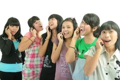 Group of girls. Group of young woman calling with mobile phone Royalty Free Stock Photos