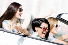 Group of girls in the auto. Group of happy girls in the auto. Little trip of teenage ladies Royalty Free Stock Photography