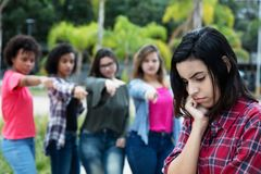 Group of girls bullying an arabic young adult woman stock photos