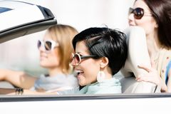 Group of girls in the car Royalty Free Stock Photography