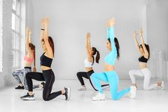 A group of girls dancing in the gym. The concept of sports, a healthy lifestyle, fitness, stretching and dancing.  royalty free stock images