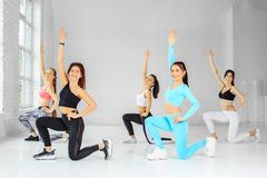 A group of girls dancing in the gym. The concept of sports, a healthy lifestyle, fitness, stretching and dancing.  stock photos