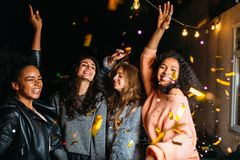 Group of girls dancing at night outdoors Stock Images