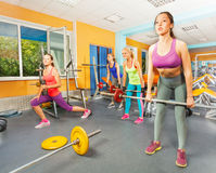 Group of girls deadlift in fitness club Stock Photos