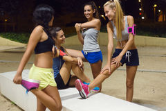 Group of girls doing stretching at night. Stock Image