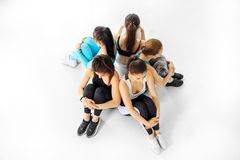 A group of girls is engaged in a dance class. The concept of sports, a healthy lifestyle, fitness, stretching and dancing.  stock photo