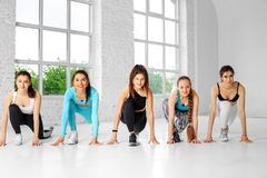 A group of girls engaged in fitness in the dance class. The concept of sports, a healthy lifestyle, fitness, stretching and. Dancing stock photo