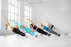 A group of girls engaged in fitness in the gym. The concept of sports, a healthy lifestyle, fitness, stretching and dancing.  stock photo