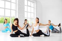 A group of girls are engaged in stretching in the gym. The concept of sports, a healthy lifestyle, fitness, stretching and dancing.  royalty free stock photography