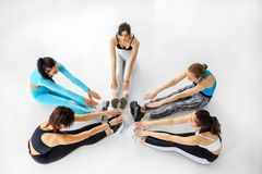 A group of girls are engaged in stretching in the gym. Copy space. The concept of sports, a healthy lifestyle, fitness, stretching. And dancing stock photos