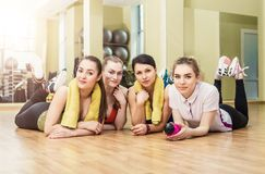Group of girls in fitness class at the break Stock Images