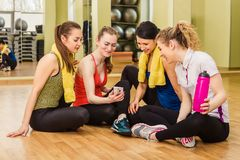 Group of girls in fitness class at the break Stock Photo