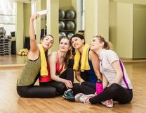 Group of girls in fitness class making selfi Stock Image