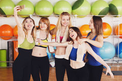 Group of girls in fitness class making selfi Stock Images