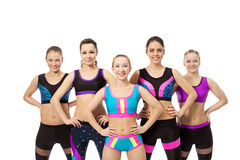 Group of girls for fitness smiling at camera Royalty Free Stock Photos