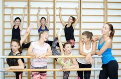 Group of girls have a rest after training, smiling and talking Royalty Free Stock Photo