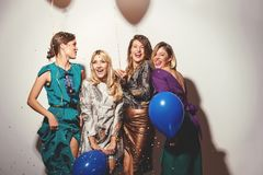 Group of girls having a party. With confetti and balloons stock image