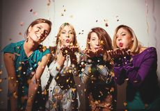 Group of girls having a party. With confetti and balloons royalty free stock photos