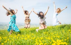 Group of girls jumping in the nature Royalty Free Stock Photos