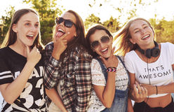 Group of girls making fun expressions Stock Photos