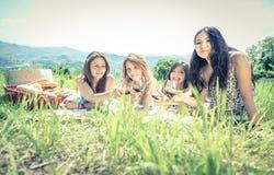 Group of girls making picnic Royalty Free Stock Photo