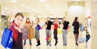 Group of girls in a mall. With shopping bags Royalty Free Stock Photography