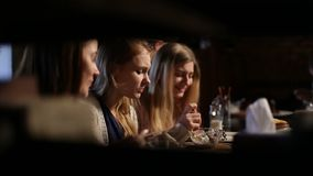 Group of girls meeting for lunch at restaurant Stock Images