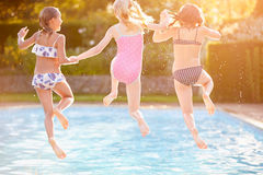 Group Of Girls Playing In Outdoor Swimming Pool Stock Photo