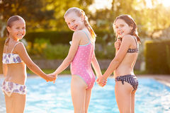 Group Of Girls Playing In Outdoor Swimming Pool Stock Photos
