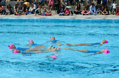Group of girls in a pool practicing synchronized swimming Royalty Free Stock Photo