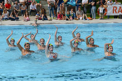 Group of girls in a pool practicing synchronized swimming Stock Photography