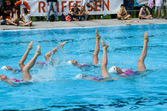 Group of girls in a pool practicing synchronized swimming Royalty Free Stock Image