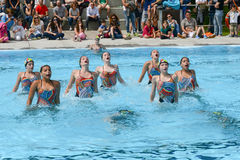 Group of girls in a pool practicing synchronized swimming Stock Photo