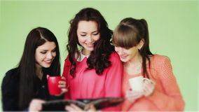 Group of girls reading a fashion magazine stock video footage