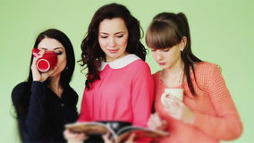 Group of girls reading a fashion magazine stock video