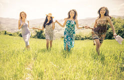 Group of girls running in a field Royalty Free Stock Photography